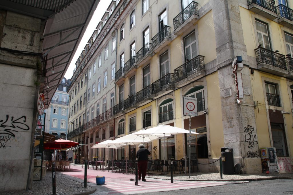 cleaning Pink Street in Lisbon